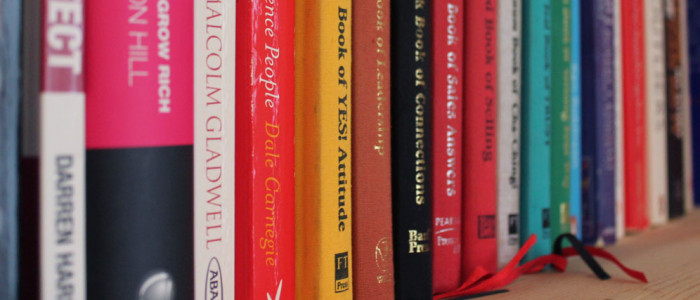 Image of books on a shelf.